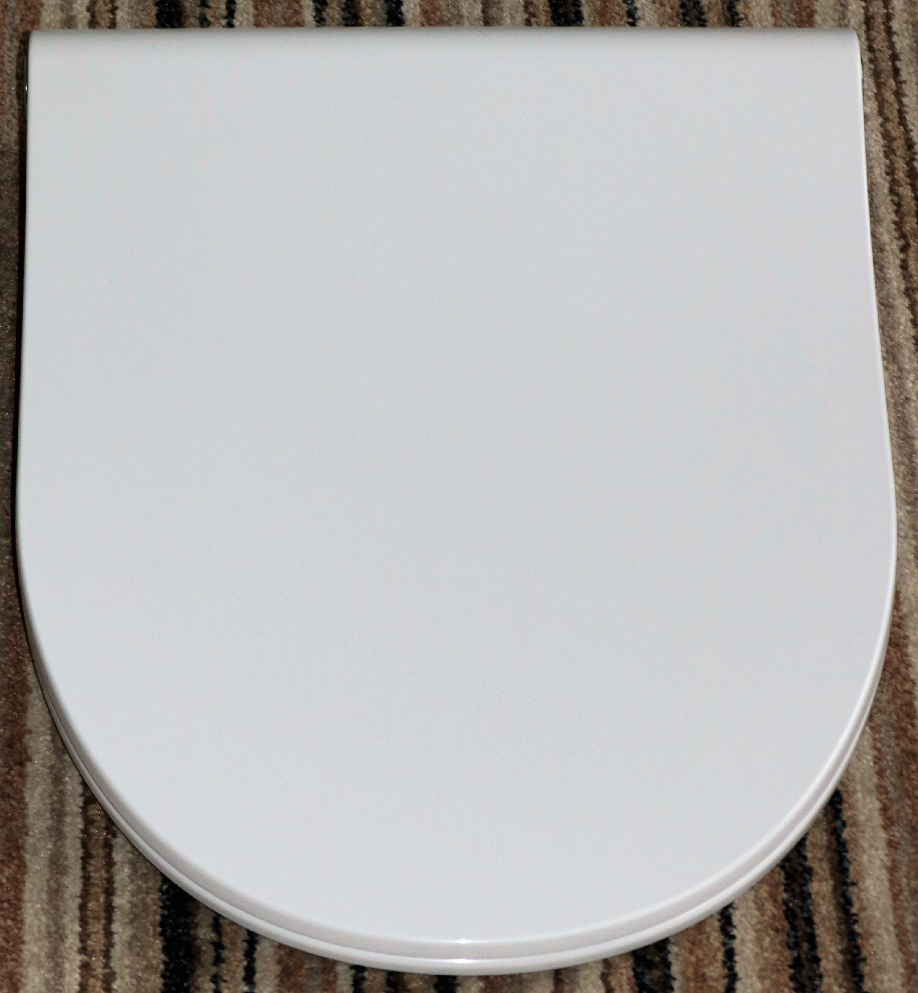 Pressalit Sway-D Seat in White